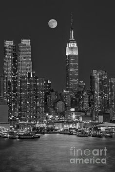 Moonrise along the Empire State Building. Susan Candelario New York City NYC skyline