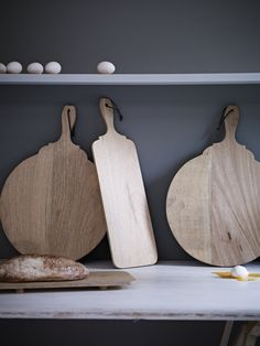 Wooden Platters. A brilliant way of presenting food. These natural mango wood platters have generous handles for easy carrying, with wooden supports underneath to make them really stable. Comes with a leather thong for hanging when not in use.