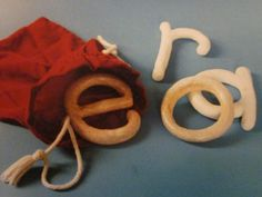 """A Mystery Bag with large clay letters to be felt through the bag & guessed at. from Inspired Montessori and Arts at Dundee Montessori ("""",). Could do this with spelling words Preschool Writing, Preschool Curriculum, Kindergarten Literacy, Early Literacy, Preschool Classroom, Literacy Activities, Activities For Kids, Reggio Classroom, Montessori Preschool"""