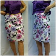 Pink purple flowers on white SKIRT Pink n purple flowers on white SKIRT,  back hidden zipper, center back hem slit.. thin material,  not lined, easily dressed up for business and really cute with strappy sandals for summer fun. Machine wash  (personally, I would use light iron but not necessary) Dress Barn Skirts