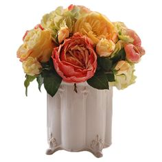 Faux roses in a footed ceramic vase with fleur-de-lis accents.  Product: Faux floral arrangementConstruction Materia...