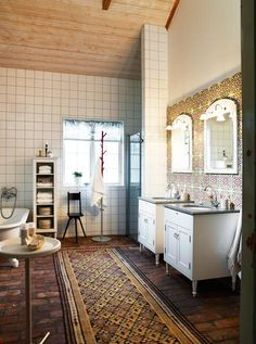 LOVE!  Global styled bathroom - gorgeous tiles, exposed brick floor and eclectic runner mat.