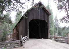 The historical covered bridge over Merced River at the Pioneer Yosemite History Center in Wawona, Yosemite National Park, California, USA.