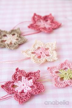 Five petals tiny crochet flower by Anabelia - tutorial to make these - only two rounds each