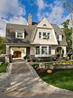 THIS is the roofline I want when we reno the house!  Love the bay window too, but that may not make it.