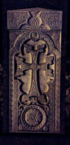 Xachqar Khachkar Armenian stone cross. A khachkar, is a carved, memorial stele bearing a cross, and often with additional motifs such as rosettes, interlaces, and botanical motifs. Khachkars are characteristic of Medieval Christian Armenian art. (V)