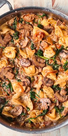 Creamy Spinach Mushroom Tortellini with Caramelized Onions is an Italian pasta dish packed with veggies. This easy and delicious meatless recipe is a perfect weeknight dinner! If you're looking for a simple creamy tortellini recipe, Entree Recipes, Pasta Recipes, Dinner Recipes, Dinner Ideas, Chicken Recipes, Creamy Spinach, Creamy Pasta, Creamy Mushroom Pasta, Creamy Mushrooms