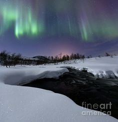 Aurora Borealis over Blafjellelva River in Troms County_Norway