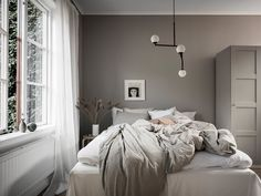From wood furniture to attractive decor ideas, jazz up your plain bedroom with these inspiring Scandinavian bedroom interior design hacks. Winter Bedroom Decor, Bedroom Decor On A Budget, Dark Blue Bedrooms, Airy Bedroom, Taupe Bedroom, Scandinavian Interior Design, Scandinavian Apartment, Carpet Colors, Wabi Sabi