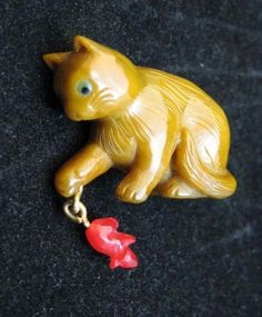 Cat button. I believe these are hand carved. Check the site for more cool buttons.