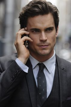 Oh My! What a sensual mouth!!!!  And eyes... and hands... and hair... Ahhhhh... a handsome man in a suit!!! Ufff!!