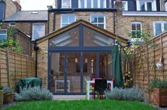 Rear Extension with full width folding sliding doors, and the windows going all… Extension Veranda, Conservatory Extension, Cottage Extension, Glass Extension, Roof Extension, Extension Ideas, Conservatory With Tiled Roof, 1930s House Extension, Extension Designs