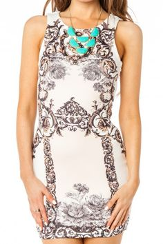 love the dress, especially with that adorable necklace!