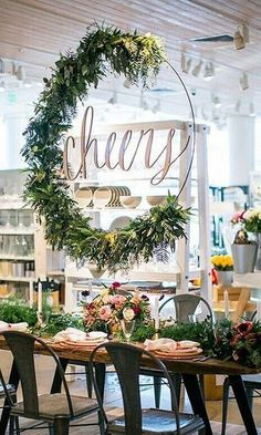 Swooning over this cheers sign! The greenery, the hoop, the beautiful tablescape. It all came together to create this magical atmosphere that we would all love to be in. Tag a friend who wants this sign! #Cheers #Inspo #LaserCut #PSWeddingsAndEvents