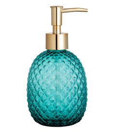 Teal. Soap pump in textured glass with a plastic pump at top. Size approx. 3 1/4…