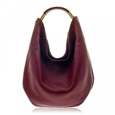 Moby Hobo by Etienne Aigner.  Loved these bags since 1961!!! Did they invent Cordovan?!