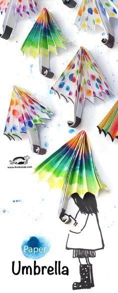 Regenschirme falten und auf ein Bild kleben.