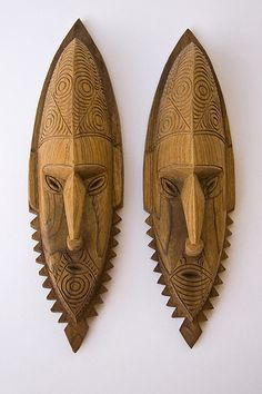 Tribal masks are from Lou Island in the Admiralty Island Group of Papua New Guinea.