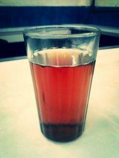 A glass of warm bitter tea