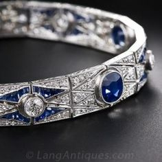 This exquisite original Art Deco bracelet is hand fabricated in platinum and features a highly decorative repeating geometric pattern that is quintessential 1920s chic. The bracelet is 7 1/4 inches long and 1/2 inch wide and features five electric-blue sapphires surrounded by accent diamonds that glitter in a geometric scissor-cut pattern. The five sapphire sections alternate with five European-cut diamond sections flanked by calibre blue sapphires. A mesmerizing Art Deco jewel!