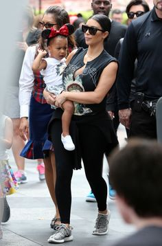 At Disneyland with North West to celebrate Penelope Disick's birthday.