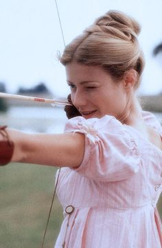 In the 1996 film Emma, based on the Jane Austen novel, Emma Woodhouse (played by Gwyneth Paltrow) playfully practices archery with Mr. Knightley as they Emma Woodhouse, Emma 1996, Jane Austen Movies, Little Dorrit, Bon Film, Image Film, Becoming Jane, Movies And Series, Pride And Prejudice