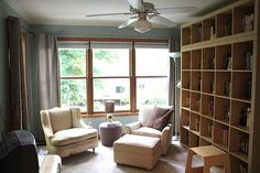 I have been yearning to have a library my entire life and when we bought our new house I knew that this Sitting Room off of our bedroom woul. Modern Mantle, Hawaiian Homes, Ikea Expedit, Modern Shelving, New Homes, Bedroom, House, Study, Spaces