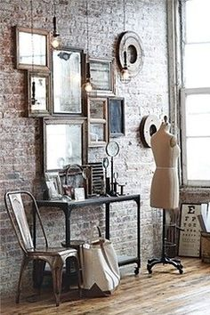 bedroom... mirrors on the wall... tv stand old metal rolling cart