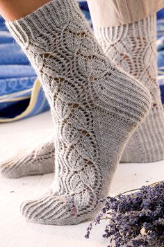 The Scent of Lavender pattern from Around the World in Knitted Socks: 26 Inspired Designs by Stephanie van der Linden, as shown in RavelryNot for sale on ravelry. A variety of lace patterns originated in Spain, but lace knitted stockings came into th Lace Socks, Crochet Socks, Knit Or Crochet, Knitting Socks, Baby Knitting, Knit Socks, Free Knitting, Ravelry Crochet, Lace Knitting Patterns