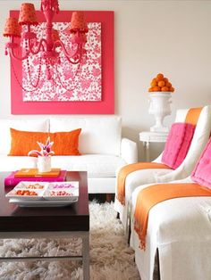 In this all-white room, vibrant orange and pink accents create a fashionable living space. This space would be perfectly paired with Nixon Upholstery: http://fabricseen.com/product/nixon-geometric-upholstery-fabric-raspberry/