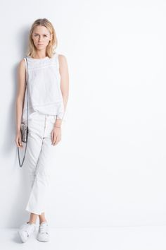 Zadig & Voltaire sleeveless top, inset lace details, mother-of-pearl buttons on the back, 100% cotton.