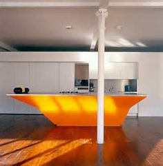 orange: couldn't pass up this image of unusually shaped island as a bright center-piece for a room.