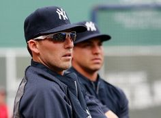 BOSTON, MA - AUGUST 1: Stephen Drew #14 of the New York Yankees stretches with teammate Jacoby Ellsbury before a game with the Boston Red Sox at Fenway Park on August 1, 2014 in Boston, Massachusetts. Drew was recently traded to the Yankees. (Photo by Jim Rogash/Getty Images)