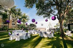 Suspended paper lanterns serve as decorative and functional lighting  at this Conrad Bali reception.