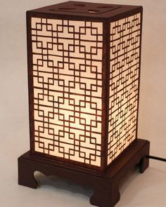 The design of the lattice is taken from the traditional hanok (Korean house) window. There is a button under the lamp so that the user can choose from three levels of brightness. Oriental Table Lamp with Korean Mulberry Yellow Paper Lanterns. Touch Lamps Bedside, Unusual Table Lamps, Handmade Lanterns, Paper Lampshade, Paper Table, Oriental Decor, Novelty Lighting, Table Lamps For Bedroom, Window Design
