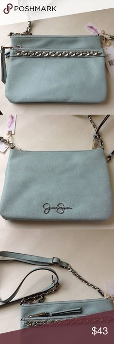 Jessica Simpson double pocket crossbody bag Jessica Simpson crossbody bag.  Double pocket with zippers, adjustable strap.  2 pockets inside bag plus key fob.  Brand new, never used with tags.  Does have 2 small marks on bottom front pls see pics.  Small front zipper got caught on inside fabric now fixed.seafoam green Jessica Simpson Bags Crossbody Bags