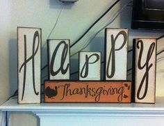 Happy Thanksgiving mantle decoration.  Used wooden blocks, scrapbooking paper, vinyl and modge podge.   Using my cricut, too.  The backside says Merry Christmas!