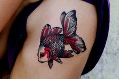 50 Awesome Fish Tattoo Designs | Cuded I want this as a tattoo, but elongated and with blues, purples and greens. It'll wrap around my lower right hip, side to back.