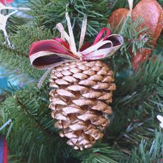 "Golden Pinecone Ornament.  Might be easy enough for a Christmas craft for kids. (Could add ""snow"" and a small bird at the top.)"
