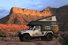 Jeep Action Camper ($54000) - Includes pop-up roof, fiberglass body, king-size bed, plenty of storage, mini-kitchen with three-burner stove and refrigerator, toilet with optional kitchen sink shower, and a fold-up dining area.