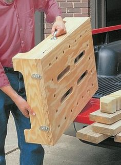 "Turn a single sheet of plywood and a few pieces of hardware into a portable workbench that ""knocks down"" for compact storage. Workbench Plans Diy, Portable Workbench, Workbench Designs, Mobile Workbench, Folding Workbench, Woodworking Bench Plans, Woodworking Crafts, Woodworking Shop, Workbench Top"