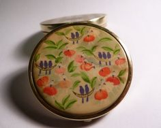 An unused enamel Stratton compact and matching Lipview in the original presentation case.