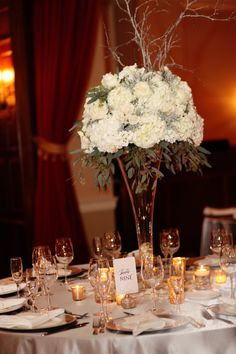 Tall Winter Wedding Centerpiece by Stems featuring Brian Ambrose Photography