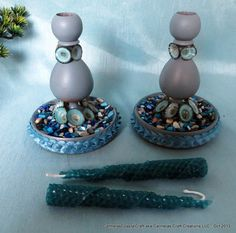 These would make a lovely gift for the holidays for a loved one or for yourself!   Upcycled wood candle holders enhanced with crushed multi colored blue sea shells and pretty turquoise limpet shells...one of my favorite shells.    cottage chic Candle holders for by CarmelasCoastalCraft, $32.00