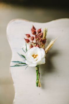 dried wheat boutonniere - photo by Julie Lim, styling by Sarah Park Events - http://ruffledblog.com/watercolored-fourth-of-july-inspiration/