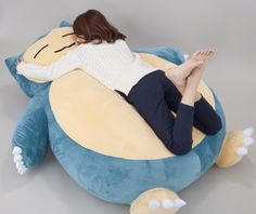 . Bandai made a Snorlax bed. Okay, maybe it's not officially a bed, but it IS a 59-inch tall, two-foot thick, plush Snorlax that you can lay on and sleep