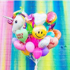 Colorful balloons with unicorn and rainbow