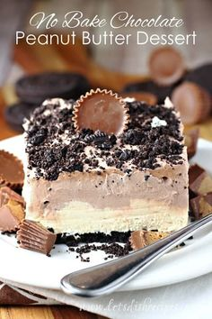 Chocolate Peanut Butter No-Bake Dessert: Peanut butter cups sandwiched between layers of chocolate and peanut butter mousse on an Oreo crumb crust.