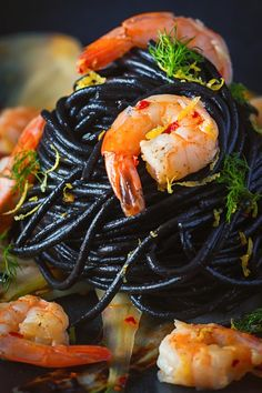 Bring a bit of bling to your spaghetti with shrimp by adding some squid ink pasta and the classics chili, garlic and lemon juice. Shrimp Recipes, Fish Recipes, Pasta Recipes, Cooking Recipes, Squid Recipes, Squid Ink Spaghetti, Squid Ink Pasta, Black Spaghetti, Black Pasta