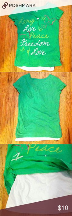 """SO Top SO brand green top with white under layer. Size XL (16). The straps of the under layer was attached but one side came undone (you could cut the string that attaches the other side so that you can wear them separately, if you'd like). Three buttons on top of front. There are butterflies on the front and the shirt says """"Long Live Peace Freedom & Love"""" across the front. 100% cotton. Made in Guatimalo. SO Shirts & Tops Blouses"""